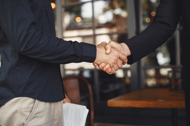 Men shake hands - business agreement business partners which are companies in Bulgaria